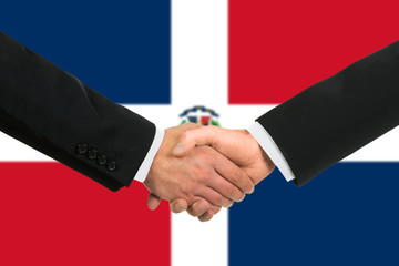 The Dominican Republic flag and business handshake.