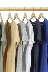 Choice of clothes of different colors on wooden hangers
