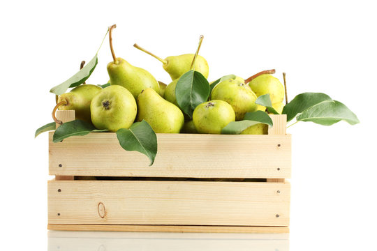 Juicy flavorful pears in box isolated on white