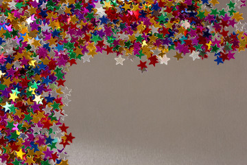 stars confetti on gray background