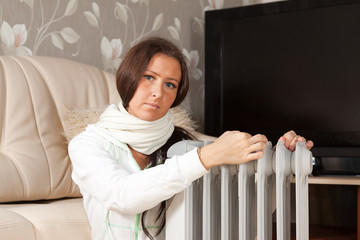 woman   near warm radiator