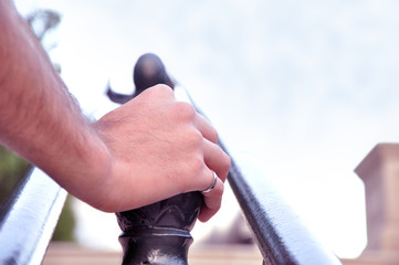 hand on railing