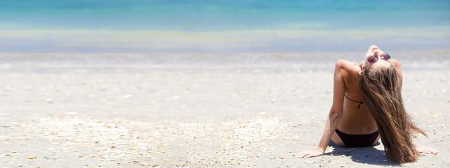 panorama of long haired girl in bikini on tropical bali beach