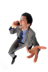 Peppy businessman talking on his mobile phone