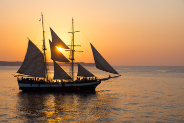 A sailing ship at sunset
