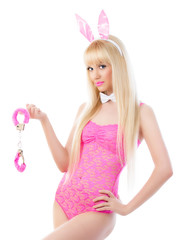 Pretty blonde girl in bunny ears with handcuffs