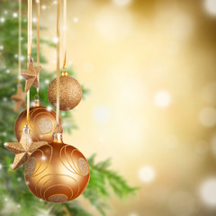 Christmas theme with golden glass balls and free space for text