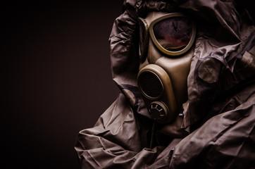 Man with a gas mask wearing hazmat suit - close up