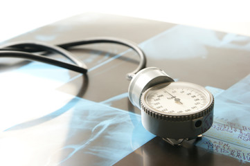 Close-up image of a stethoscope and x-ray images