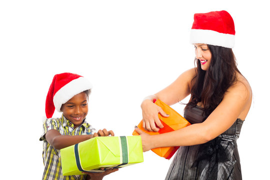 Happy woman and boy opening Christmas gifts
