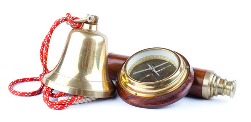 marine bell, compass and telescope isolated on white