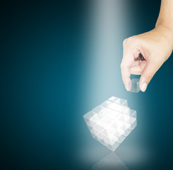 male Hand pick a piece of glass cube