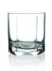 Crystal empty glass to whiskey. On a white background.