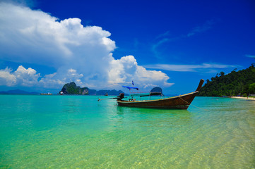 small boat floating on the paradise.