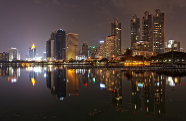 Bangkok in evening, reflection of buildings in water