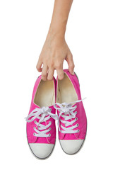 Bright Pink Canvas Shoes Handle On White Background.