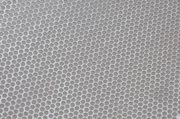 Metal sheet surface with holes