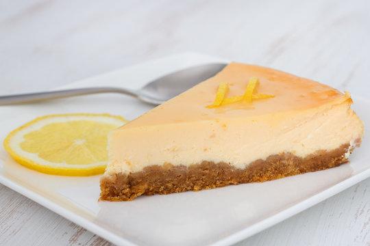 lemon cheesecake on the plate with lemon