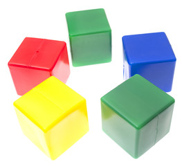 Children's pyramid from color cubes isolated on white background
