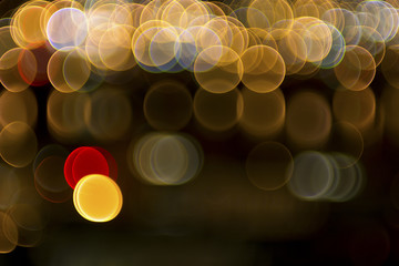 Bokeh lights from downtown busy traffic