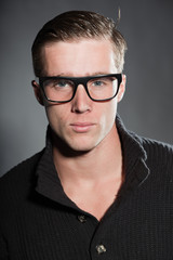 Fashion beauty portrait of young man with retro glasses.