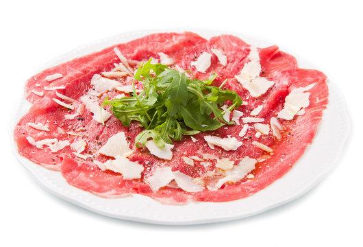 carpaccio of beef on arugula