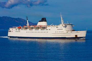 Ship on its way to Mykonos island port in cyclades Greece