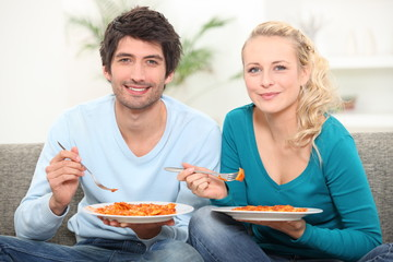 couple having dinner on the couch