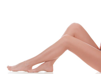 Long female legs after depilation, isolated on white