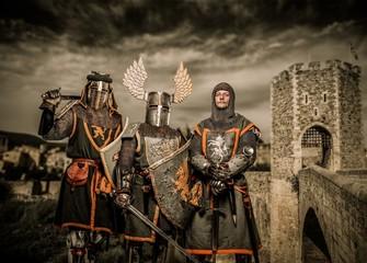 Foto op Canvas Ridders Three knight in armor