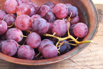 Bunch of grapes on rustic background