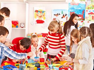 Child painting at art school.