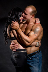 Muscular man and a woman