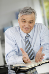 Senior businessman meeting client in office