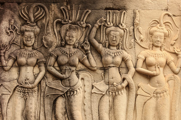 four apsaras on the wall of Angkor wat, Cambodia