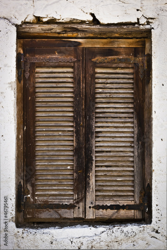 Wall mural Traditional old wooden window in Greece
