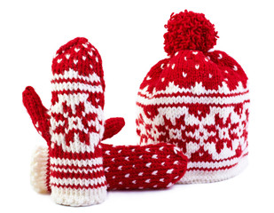 winter cap and mittens hand knitted, isolated