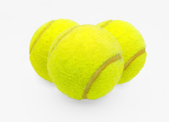 Three tennis balls on a white background