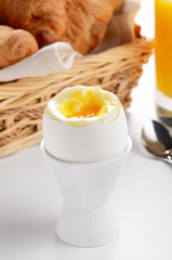 Boiled egg, orange juice, croissants