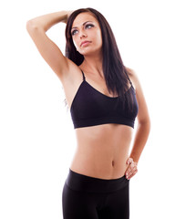 Sporty hispanic woman standing with hand on hip