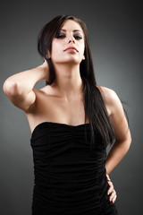 Beautiful latin woman standing with hand on hip