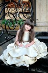 portrait of little girl outdoors in Princess dress