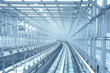 Tokyo monorail transportation system line metal tunnel. Blue ton