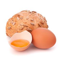 Bun with seeds and broken egg