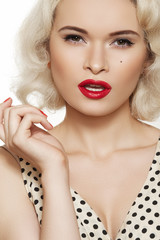 Fashion woman model with red lips make-up, curly blond hair