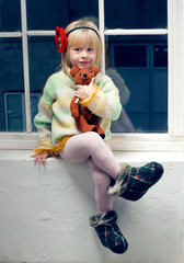 year 3 old girl in knitted sweater and tights