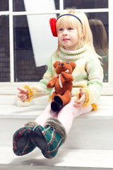 blonde little girl in knit sweater
