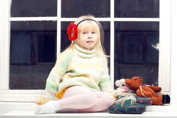 blonde little girl in knitted sweater