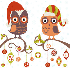 Christmas card of owls in hats sitting on a tree branch