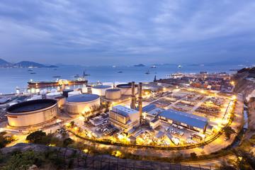 Oil tanks industry scene at night